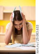 Купить «Young woman wife in budget planning concept», фото № 29083633, снято 12 июня 2018 г. (c) Elnur / Фотобанк Лори
