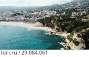 Купить «Picturesque aerial view of Mediterranean coastal town of Lloret de Mar in Catalonia, Spain», видеоролик № 29084061, снято 23 июня 2018 г. (c) Яков Филимонов / Фотобанк Лори