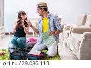 Купить «Young family packing for vacation travel», фото № 29086113, снято 30 апреля 2018 г. (c) Elnur / Фотобанк Лори