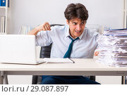 Купить «Overloaded busy employee with too much work and paperwork», фото № 29087897, снято 3 июля 2018 г. (c) Elnur / Фотобанк Лори