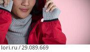 Купить «Composite image of smiling woman in hooded jacket standing against white background», фото № 29089669, снято 31 марта 2020 г. (c) Wavebreak Media / Фотобанк Лори