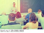 Купить «Young lecturer talking to mixed age students», фото № 29090969, снято 28 июня 2018 г. (c) Яков Филимонов / Фотобанк Лори