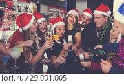 Friends on new year eve party in bar. Стоковое фото, фотограф Яков Филимонов / Фотобанк Лори