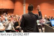 Купить «Public speaker giving talk at Business Event.», фото № 29092497, снято 22 сентября 2018 г. (c) Matej Kastelic / Фотобанк Лори