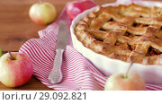 Купить «close up of apple pie and knife on wooden table», видеоролик № 29092821, снято 7 сентября 2018 г. (c) Syda Productions / Фотобанк Лори