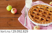 Купить «close up of apple pie and glass of milk on table», видеоролик № 29092829, снято 7 сентября 2018 г. (c) Syda Productions / Фотобанк Лори