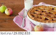 Купить «close up of apple pie and glass of milk on table», видеоролик № 29092833, снято 7 сентября 2018 г. (c) Syda Productions / Фотобанк Лори