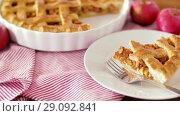 Купить «close up of apple pie and fork on plate», видеоролик № 29092841, снято 7 сентября 2018 г. (c) Syda Productions / Фотобанк Лори