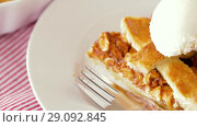 Купить «close up of apple pie with ice cream on plate», видеоролик № 29092845, снято 7 сентября 2018 г. (c) Syda Productions / Фотобанк Лори