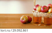 Купить «apples in basket and glasses of juice on table», видеоролик № 29092861, снято 7 сентября 2018 г. (c) Syda Productions / Фотобанк Лори