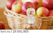 Купить «apples in basket and jug of juice on table», видеоролик № 29092865, снято 7 сентября 2018 г. (c) Syda Productions / Фотобанк Лори