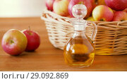 apples in basket and jug of juice on table. Стоковое видео, видеограф Syda Productions / Фотобанк Лори