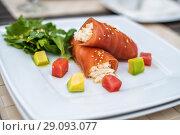 Купить «rolls of tuna with crab meat on the plate», фото № 29093077, снято 27 июня 2017 г. (c) katalinks / Фотобанк Лори