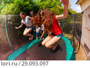 Купить «Girls and boys bouncing on the outdoor trampoline», фото № 29093097, снято 20 мая 2018 г. (c) Сергей Новиков / Фотобанк Лори