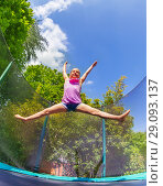 Купить «Girl acrobat split jumping on outdoor trampoline», фото № 29093137, снято 20 мая 2018 г. (c) Сергей Новиков / Фотобанк Лори