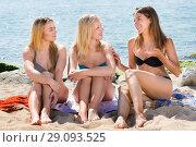 Купить «Young women chatting on beach», фото № 29093525, снято 20 февраля 2019 г. (c) Яков Филимонов / Фотобанк Лори