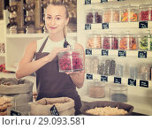 Купить «Young woman is offering dried flowers of Hibiscus in container», фото № 29093581, снято 4 сентября 2017 г. (c) Яков Филимонов / Фотобанк Лори