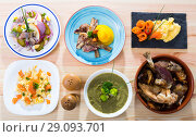 Купить «Dishes of traditional Norwegian cuisine with lamb rib, seafood and vegetables», фото № 29093701, снято 21 января 2019 г. (c) Яков Филимонов / Фотобанк Лори