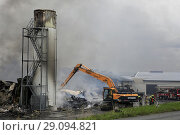 Купить «Salo, Finland. September 14, 2018. Fire destroys 5,000 square meters of production and office spaces of Finnish Candle manufacturer Kynttila-Tuote Oy....», фото № 29094821, снято 14 сентября 2018 г. (c) age Fotostock / Фотобанк Лори