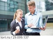 Купить «Couple professionals are examinating project on laptop», фото № 29099137, снято 15 июля 2017 г. (c) Яков Филимонов / Фотобанк Лори
