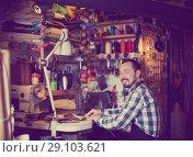 Купить «Male worker stitching new belt», фото № 29103621, снято 19 октября 2018 г. (c) Яков Филимонов / Фотобанк Лори
