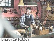 Купить «Male worker working on leather for belt in leather», фото № 29103629, снято 19 октября 2018 г. (c) Яков Филимонов / Фотобанк Лори