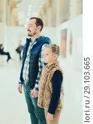 Купить «Adult father and daughter enjoying expositions», фото № 29103665, снято 20 сентября 2018 г. (c) Яков Филимонов / Фотобанк Лори