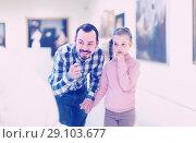 Купить «joyous father and daughter regarding paintings in museum», фото № 29103677, снято 22 сентября 2018 г. (c) Яков Филимонов / Фотобанк Лори