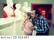 Купить «Laughing father and daughter exploring statues», фото № 29103681, снято 16 декабря 2018 г. (c) Яков Филимонов / Фотобанк Лори