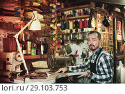Купить «Male worker stitching new belt», фото № 29103753, снято 19 октября 2018 г. (c) Яков Филимонов / Фотобанк Лори