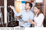 Купить «Family couple choosing for new modern functional shower mixer», фото № 29103837, снято 11 апреля 2018 г. (c) Яков Филимонов / Фотобанк Лори