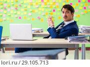 Купить «Businessman with many conflicting priorities», фото № 29105713, снято 23 мая 2018 г. (c) Elnur / Фотобанк Лори