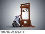 Купить «Businessman in heavy high taxes business concept», фото № 29105813, снято 5 июня 2020 г. (c) Elnur / Фотобанк Лори