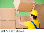 Купить «Man contractor working with boxes delivery», фото № 29108573, снято 4 июня 2018 г. (c) Elnur / Фотобанк Лори
