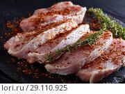 Купить «Close up of pork fillet sliced on portions», фото № 29110925, снято 25 августа 2018 г. (c) Oksana Zh / Фотобанк Лори