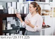 Купить «woman looking bottle for liquid soap», фото № 29111225, снято 2 мая 2018 г. (c) Яков Филимонов / Фотобанк Лори