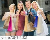 Купить «Young persons looking satisfied after shopping», фото № 29111321, снято 23 января 2019 г. (c) Яков Филимонов / Фотобанк Лори