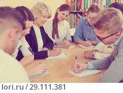 Купить «Group of students and professor working together», фото № 29111381, снято 5 октября 2017 г. (c) Яков Филимонов / Фотобанк Лори