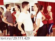 Купить «Young adults dancing in a studio», фото № 29111429, снято 21 сентября 2018 г. (c) Яков Филимонов / Фотобанк Лори