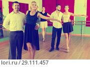 Купить «Group of people have fun while dancing waltz», фото № 29111457, снято 22 октября 2018 г. (c) Яков Филимонов / Фотобанк Лори
