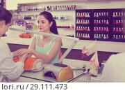 Купить «calm manicurist filing and shaping nails in beauty salon», фото № 29111473, снято 28 апреля 2017 г. (c) Яков Филимонов / Фотобанк Лори