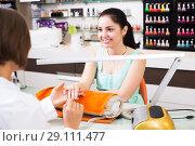 Купить «Manicure masters working», фото № 29111477, снято 28 апреля 2017 г. (c) Яков Филимонов / Фотобанк Лори