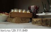 Купить «Snack on the tray On a sunny day on a white tablecloth», видеоролик № 29111849, снято 9 августа 2018 г. (c) Aleksejs Bergmanis / Фотобанк Лори