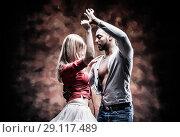 Купить «Young and sexy couple dances Caribbean Salsa», фото № 29117489, снято 22 ноября 2019 г. (c) Игорь Бородин / Фотобанк Лори