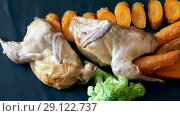 Купить «Dish of tasty quail of teriyaki with sweet carrots, fried on a grill, served with herbs», видеоролик № 29122737, снято 27 августа 2018 г. (c) Яков Филимонов / Фотобанк Лори