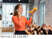 Купить «young woman calling on smartphone at shoe store», фото № 29123457, снято 22 сентября 2017 г. (c) Syda Productions / Фотобанк Лори