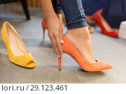 Купить «young woman trying high heeled shoes at store», фото № 29123461, снято 22 сентября 2017 г. (c) Syda Productions / Фотобанк Лори