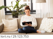 Купить «woman with tablet pc computer at home», фото № 29123753, снято 29 августа 2018 г. (c) Syda Productions / Фотобанк Лори