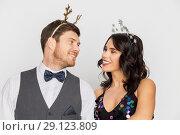 Купить «couple with christmas or new year party props», фото № 29123809, снято 15 декабря 2017 г. (c) Syda Productions / Фотобанк Лори