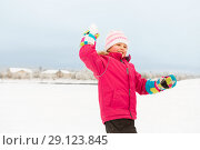 Купить «happy girl playing and throwing snowball in winter», фото № 29123845, снято 10 февраля 2018 г. (c) Syda Productions / Фотобанк Лори